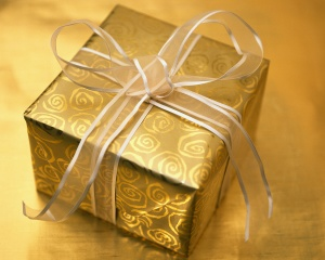 Christmas Present Wrapped in Gold and Silver